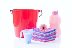 Fower, towels and laundry detergent isolated Stock Image