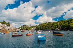 Fowey, United Kingdom - March 24, 2010: boats in sea harbor on cloudy sky. Speed and sailing boats on water. Summer stock photography