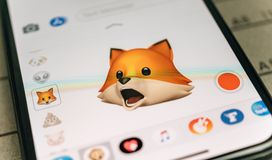 Fox animal 3d animoji emoji generated by Face ID. PARIS, FRANCE - NOV 9 2017: Fox animal 3d animoji emoji generated by Face ID facial recognition system with Royalty Free Stock Image