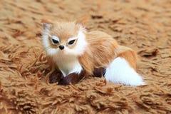 A fox at the carpet. A fox at the carpet, as background Stock Photo