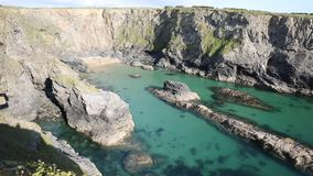 Fox Cove north Cornwall coast between Treyarnon and Porthcothan with clear turquoise blue sea stock video footage