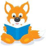 Fox cub reading a book Stock Image
