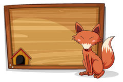 A fox beside an empty board Royalty Free Stock Photo