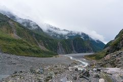 Fox Glacier valley landscape with low clouds stock photography