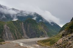 Fox Glacier valley landscape with low clouds royalty free stock photos