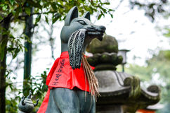 Fox Guardian in Kyoto. Fox Guardian in front of the Fushimi Inari Shrine in Kyoto stock photography