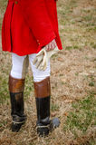 Fox Hunt Attire. Formal attire for the fox hunt. scarlet coat, boots, and sours Royalty Free Stock Photo