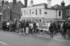 Fox hunting protest, England. Anti hunting protestors demonstrate at the Boxing Day meet of the Ashford Valley Hunt in the High Street at Tenterden in Kent stock images