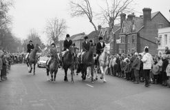 Fox hunting protest, England. Anti hunting protestors demonstrate at the Boxing Day meet of the Ashford Valley Hunt in the High Street at Tenterden in Kent stock photos