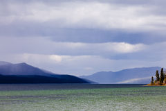 Fox Lake dark rain clouds Yukon Territory Canada Royalty Free Stock Images