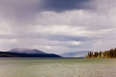 Fox Lake rain shower Yukon Territory Canada Stock Photos