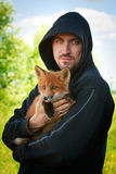 Fox and man. Red fox pup and man Royalty Free Stock Images