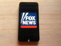 Fox News app. On smartphone kept on wooden table royalty free stock photo
