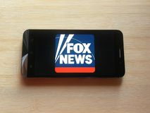 Fox News. App on smartphone kept on wooden table stock photography