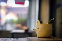 Fox Plant Pot on wooden table ,Background image is bokeh royalty free stock photo