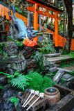 Fox purification fountain at Fushimi Inari Taisha, Kyoto, Japan Stock Photography