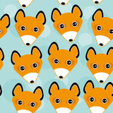Fox Seamless pattern with funny cute animal face on a blue backg Stock Photo