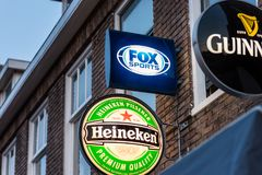 Fox Sports Heineken and Guinness logos outside bar. Fox Sports, Heineken and Guinness logos outside bar in Alkmaar, The Netherlands. Fox Sports live broadcasts Stock Photo