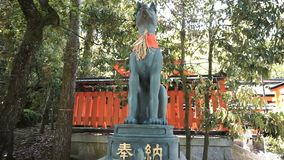 Fox Statues are often found in Fushimi Inari Taisha Shrine stock footage