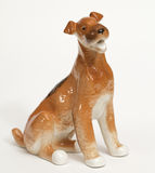 Fox terrier Dog ceramic figurine, isolated on white Stock Image