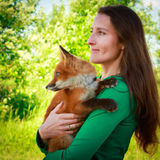 Fox and woman Royalty Free Stock Images