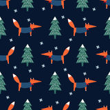 Fox, xmas tree and snowflake seamless pattern on blue background. Stock Images