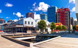 The Foxglove shopping mall with bars and restaurants around during lunch time. Queens wharf, Wellington city. New Zealand. Stock Photography