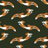 Foxs senza cuciture del modello che saltano sul fondo di colore verde Illustrazione di Stock