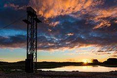 Sunset Water Park Tower. Foxton New Zealand new water park, showing it`s new cable towers. With a wonderful sunset sky stock photography