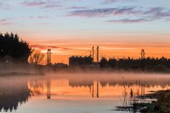 Foxton Water Park Sunrise. Foxton water park New Zealand on a mist morning sunrise stock image