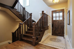 Foyer. Elegant home foyer with wood stairs and flooring Stock Images