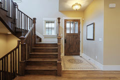 Foyer. Elegant home foyer with wood stairs and flooring Royalty Free Stock Photo