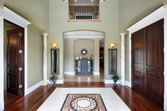 Foyer with balcony. Foyer in luxury home with balcony and floor design Stock Images