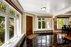 Foyer with black shiny tile floor and stone trim under the windo Royalty Free Stock Image