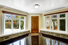 Foyer with black shiny tile floor and stone trim under the windo Stock Photo