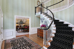 Foyer with carpeted staircase Stock Photos
