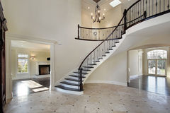 Foyer with circular staircase. Foyer in new construction home with circular staircase Royalty Free Stock Photo