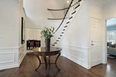 Foyer with curved staircase Stock Photography