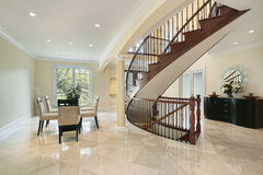 Foyer with curved staircase Royalty Free Stock Image
