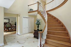 Foyer with curved staircase Royalty Free Stock Photography