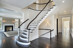 Foyer with curved staircase Stock Photo