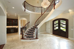 Foyer with curved staircase Stock Images