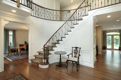 Foyer with curved staircase Royalty Free Stock Photo