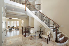 Foyer with curved staircase. Foyer in new construction home Royalty Free Stock Photography