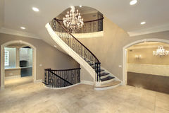 Foyer with curved stairway Stock Photo
