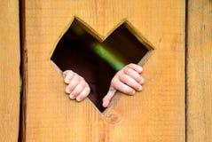 Foyer d'amour en bois avec la main Photos stock