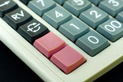 Foyer financier de calculatrice sur les boutons vides roses Photographie stock libre de droits
