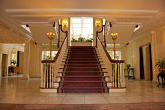 Foyer in luxurious house. Formal staircase in foyer or entrance hall of luxurious house or stately residence stock photography