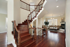 Foyer in luxury home. With cherry stairway Royalty Free Stock Photography
