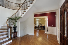 Foyer in luxury home with curved staircase Stock Images